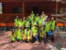 Adopt a Highway Volunteer Group in front of cabin