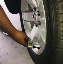 Checking tire pressure is part of monsoon safety
