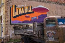 Logo on building from Lowell