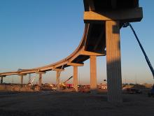 Crews work on the new ramp connecting westbound Sky Harbor Boulevard to SR 143.